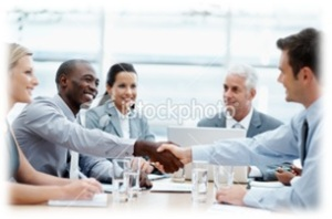 People Shaking Hands Across Table